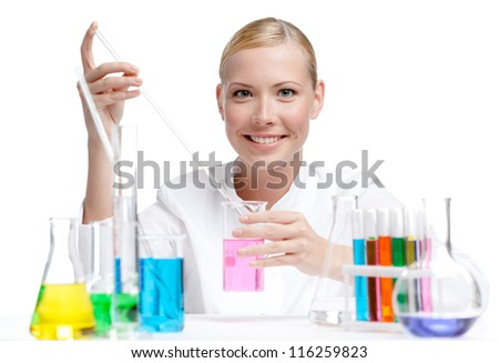 Female doctor surrounded by medical vials and flasks makes some researches, isolated on white - stock photo