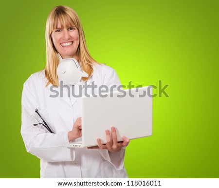 Female Doctor Using Laptop against a green background