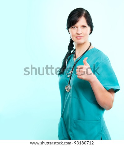 Female doctor wearing green scrubs, added copy space