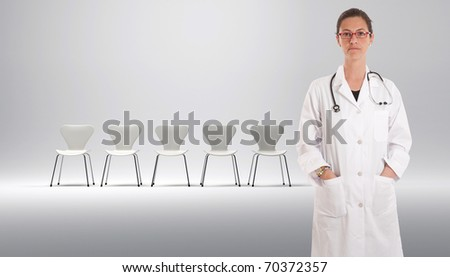 Female doctor with a row of white chairs at the background