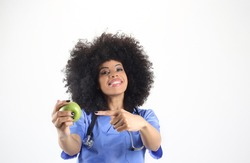 Female doctor with an apple in hand, afro woman white background