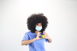 Female doctor with an apple in the heart white background