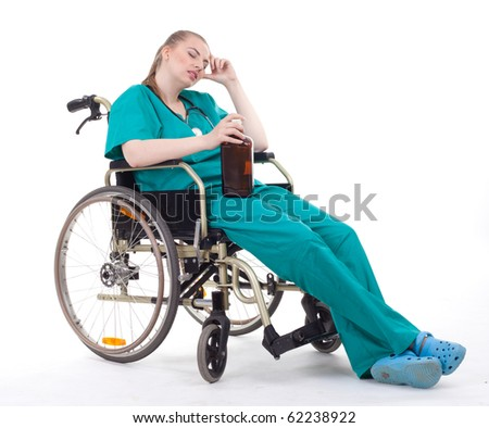 female doctor with brown bottle of alcohol on wheelchair