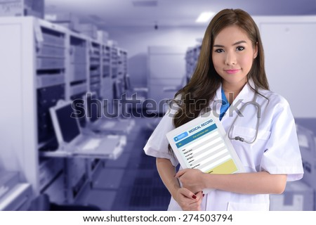 Female doctor with electronic medical record on blue background of computer system.