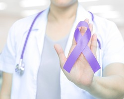 Female doctor with lavender violet orchid awareness ribbon in hand for Cancer awareness (all kinds),Craniosynostosis,Epilepsy,Gynecological Cancer ,Hodgkin's lymphoma,National Cancer Prevention Month