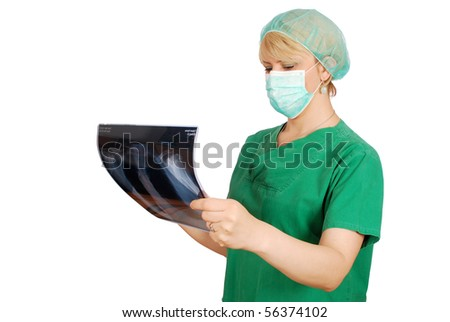 female doctor with mask examining x-ray