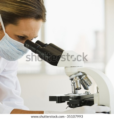 Female Doctor with Microscope