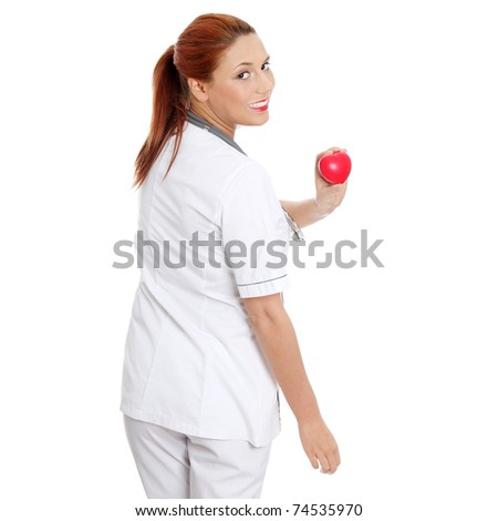 Female doctor with stethoscope holding heart. Isolated on white
