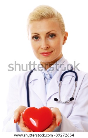 Female doctor with stethoscope holding heart  isolated on white background.