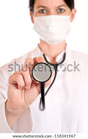 Female doctor with stethoscope in selective focus