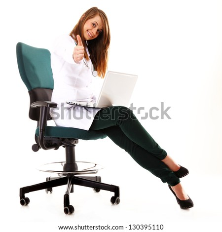 Female doctor working on her laptop showing thumbs up against a white background