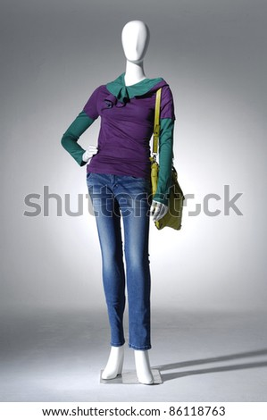 Female dress in jeans with handbag on mannequin isolated