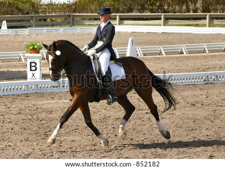 female dressage rider in competition
