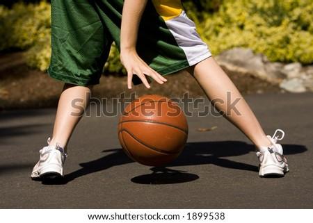 Female Dribbling a Basketball
