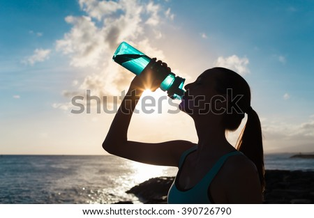 Female drinking water on a hot day.
