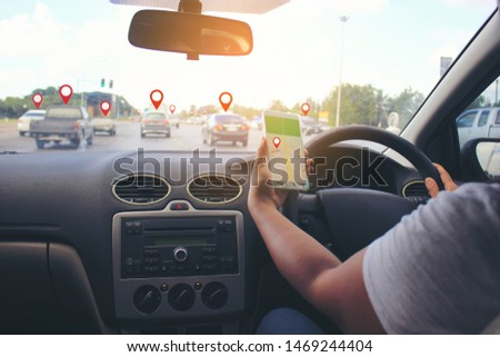 Female driver hands holding the car steering panel with holding smartphone for checking map gps navigation and pins or gps map on vehicles on the highway  #1469244404