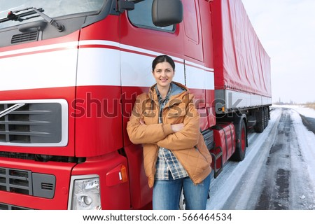 Female driver near big modern truck outdoors #566464534