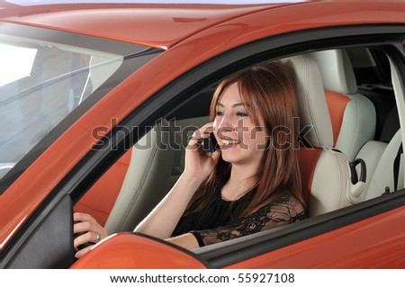 Female driver on phone while driving - a series of NEW CAR images. - stock photo