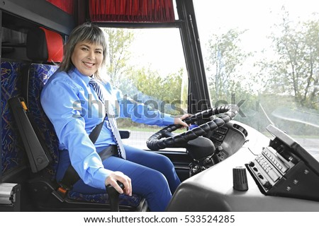 Female driver sitting in bus #533524285