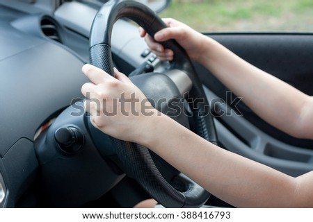 Female driving car #388416793