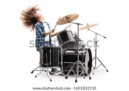 Female drummer playing on a drum set and throwing hair back isolated on white background ストックフォト ©