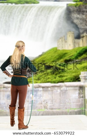 Stock Photo female elf looking at castle holding bow