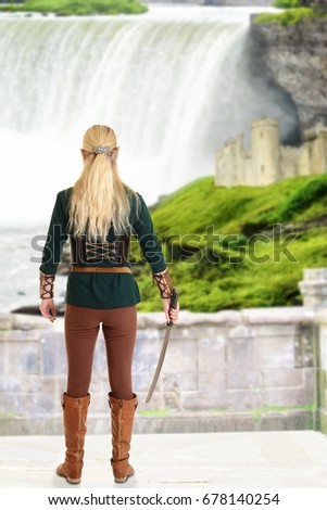 Stock Photo female elf with sword looking at waterfall