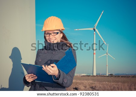 Female Engineer in Wind Turbine Power Generator Station