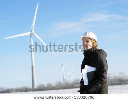female engineer with wind turbines