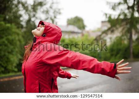 Female Enjoying Rain