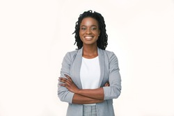 Female Entrepreneur. Afro Business Girl Smiling At Camera Crossing Hands On White Studio Background. Copy Space, Isolated