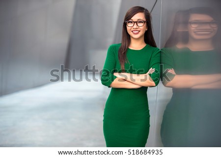 Female entrepreneur professional standing smiling with glasses and fashionable confidence
