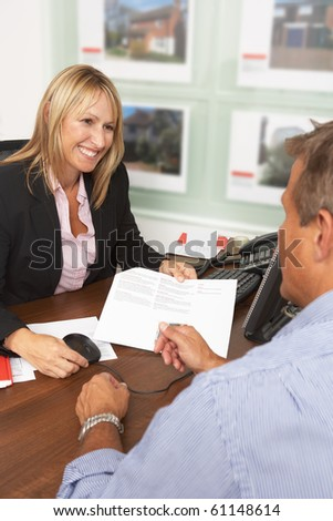 Female Estate Discussing Property Details With Client