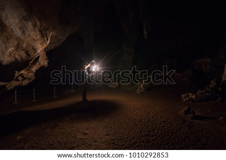 Female explorers hold lanterns inside the cave, Tham Pai, Mae Hong Son,Tham Lod Cave one of the most amazing cave in Thailand.