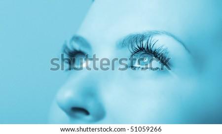 Female eye close up. A blue tonality. Selective focus