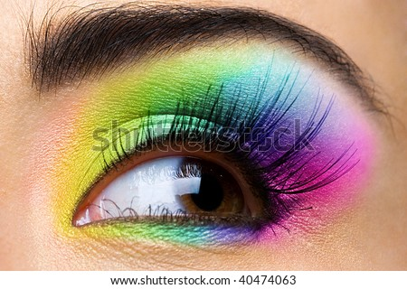 Female eye with rainbow make-up and long eyelashes