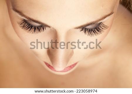 female face and eyes with false eyelashes