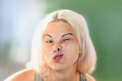 female face pressed against glass or window, funny female face expression