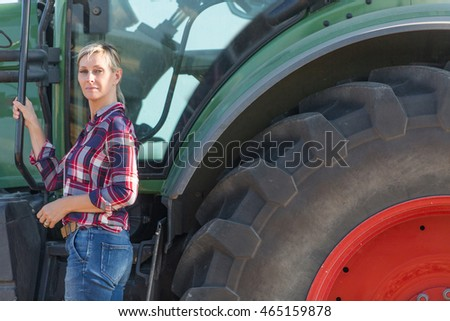 Female Farmer And Her Tractor Stock Photo 465159878 ...