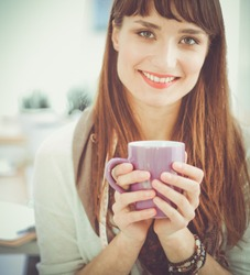 Female fashion designer with cup of coffee