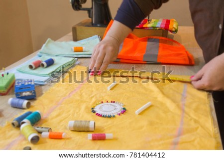 Female fashion designer working at studio with pattern cuttings and sketches. Garment industry, tailoring concept #781404412
