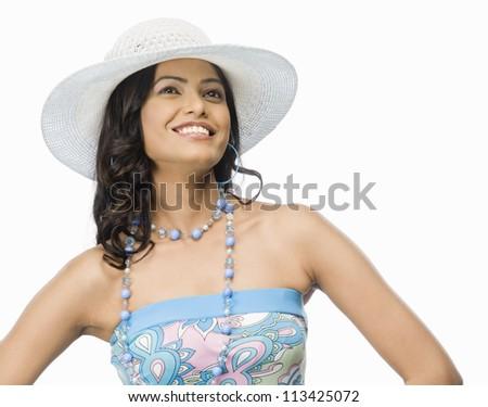 Female fashion model posing against white background