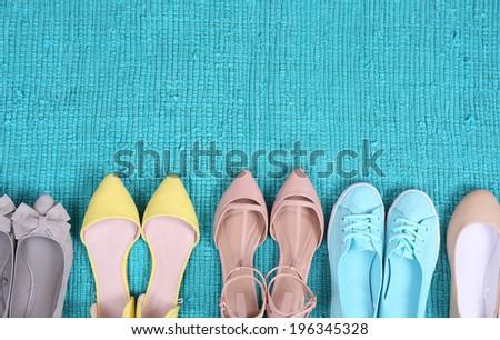 Female fashion shoes on blue carpet