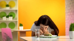 Female feeling nausea sitting canteen table, junk meal poisoning, food quality