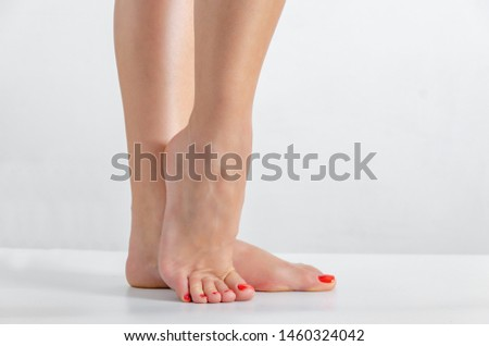 Female feet, feet stand on a white background, Smooth skin, foot care #1460324042