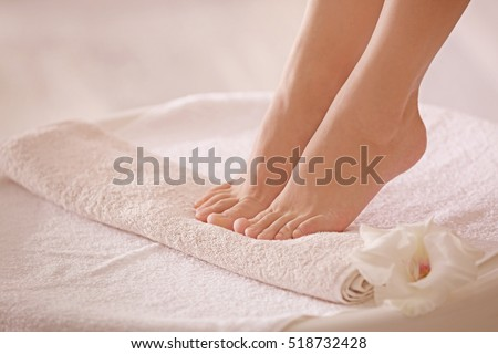 Female feet in spa salon, closeup #518732428