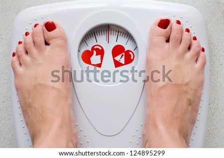 Female feet on bathroom scale with concept symbols for health care