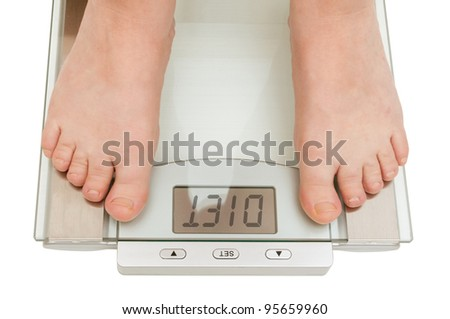 Female feet on scales isolated on white - Diet Sign on Display