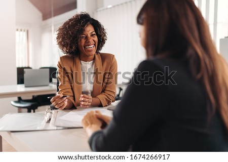 Female financial advisor consulting a client