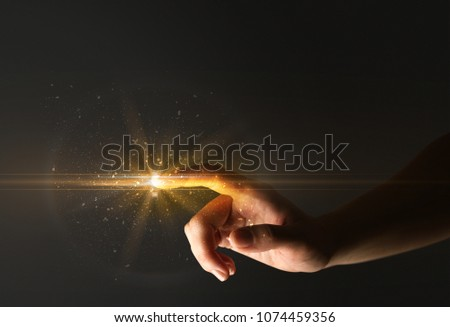 Female finger touching a beam of light #1074459356